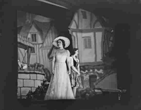 Queen Elizabeth II and Princess Margaret on stage during the Christmas pantomime 'Old mother red riding boots' at Windsor Castle, England on December 23, 1944.