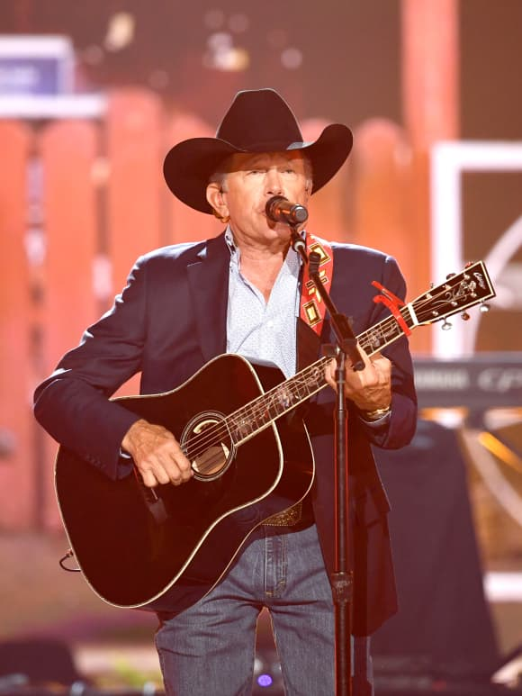 George Strait performing at the 54th Academy Of Country Music Awards
