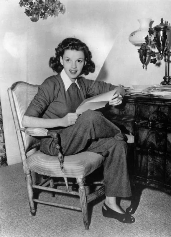 1944: American film actress Judy Garland (1922 - 1969) at home answering fan mail.