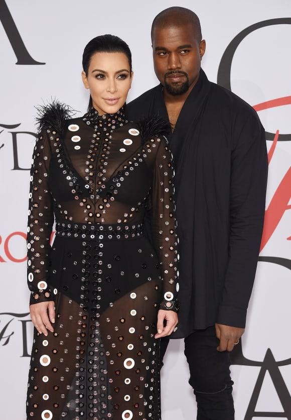 Kim Kardashian and rapper Kanye West attend the 2015 CFDA Fashion Awards.