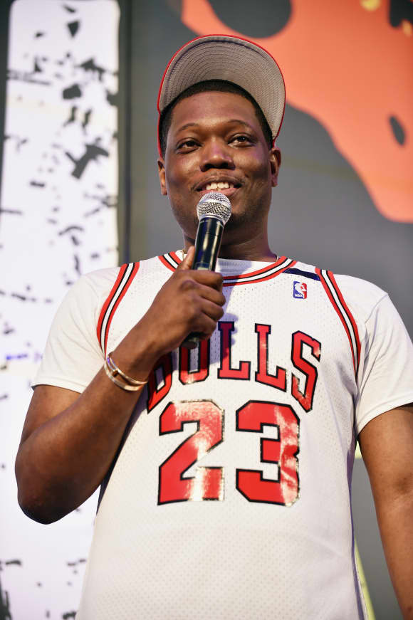 Comedian Michael Che performs onstage during OZY FEST 2017.