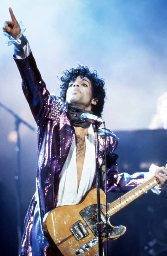 American singer Prince performs onstage during the 1984 Purple Rain Tour on November 4, 1984.