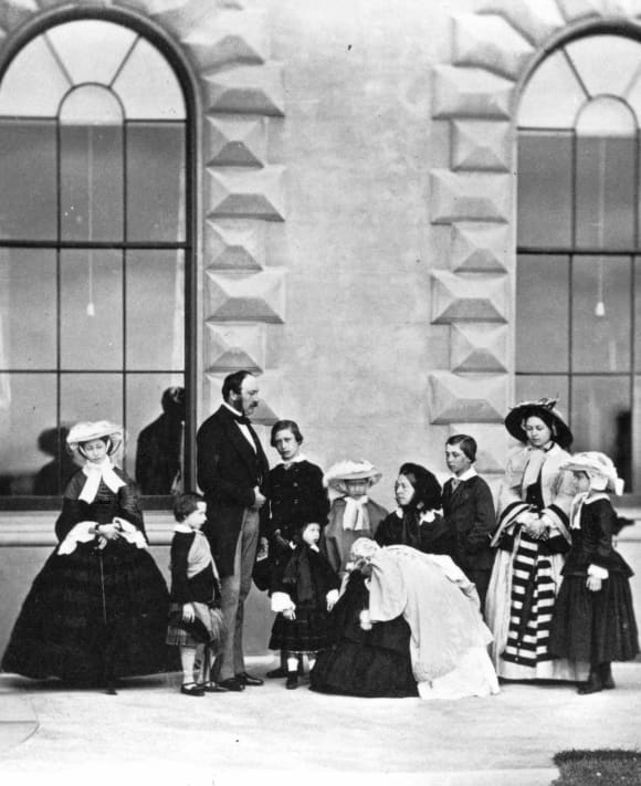 Queen Victoria and Prince Albert with their 9 kids, 1857.