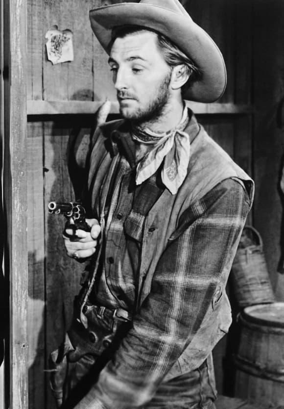 "Robert Mitchum as ""Rigney"" in Hoppy Serves a Writ (1943)."