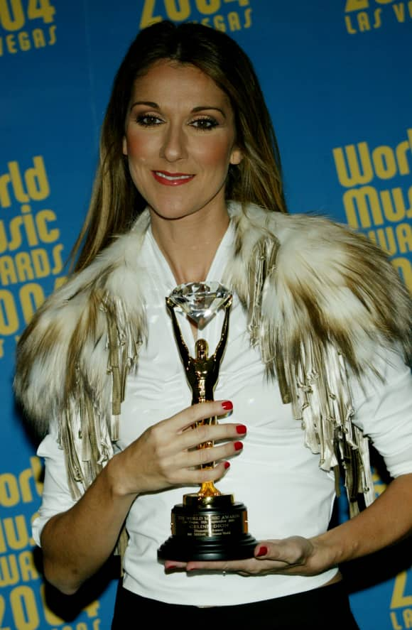 Celine Dion, winner of the Diamond Award, poses backstage at the 2004 World Music Awards at the Thomas and Mack Center on September 15, 2004