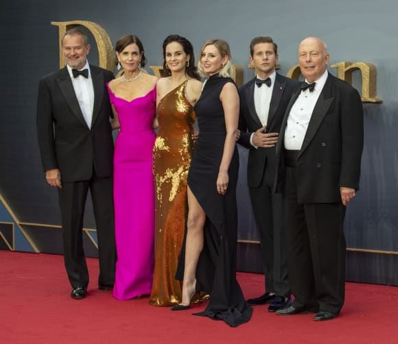 The cast of the Downton Abbey movie on the red carpet with Julian Fellowes.