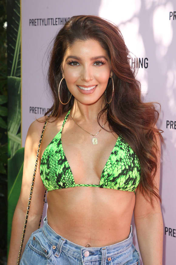 Melissa Molinaro poses in a bikini at an event for Ashanti!