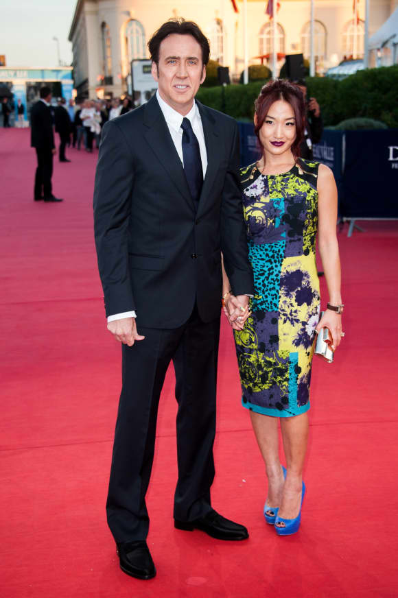 Nicolas Cage and Alice Kim arrive at the premiere of the movie 'Joe' on September 2, 2013